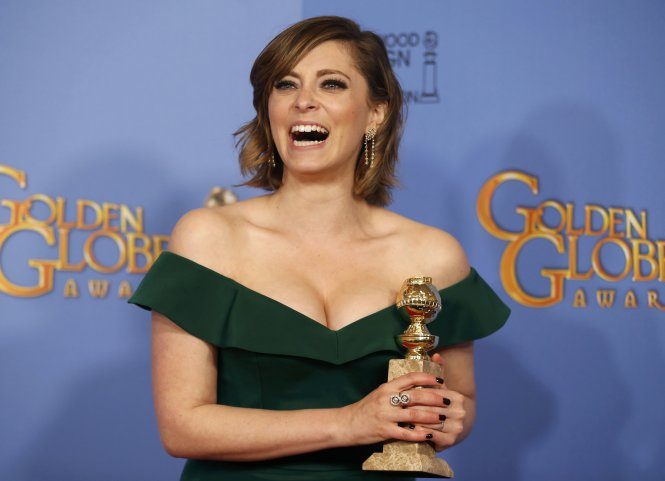 Rachel Bloom poses with her award for Best Performance by an Actress in a Television Series - Musical or Comedy for her role in