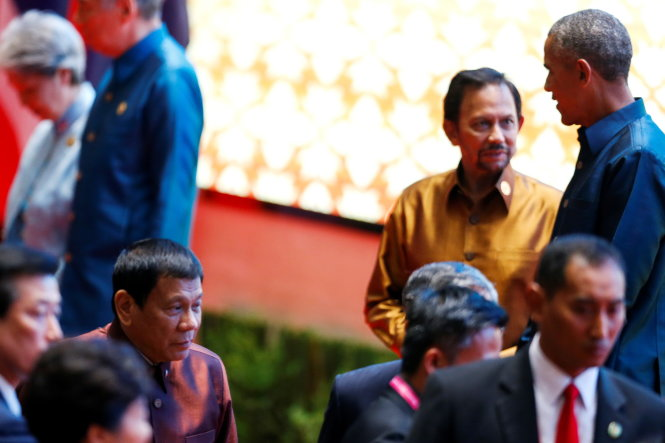 Philippine President Rodrigo Duterte arrives at the ASEAN Summit family photo while U.S. President Barack Obama chats with the Sultan of Brunei Hassanal Bolkiah in Vientiane, Laos September 7, 2016.