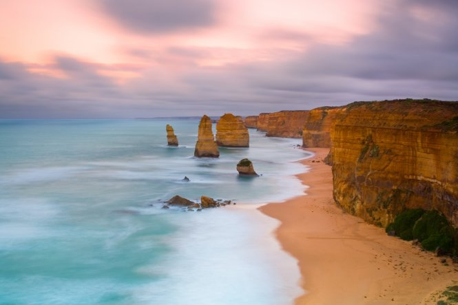 Head off on a road trip along Australia's Great Ocean Road and be sure to get a head start on the driving just as the sun comes up, captured here from the Twelve Apostles Marine National Park© Getty Images