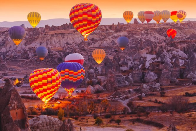 Not many destinations in the world inspire such wanderlust as the Turkish Cappadocia mountains, best enjoyed from a hot air balloon at sunrise © Shutterstock / Symonenko Viktoriia