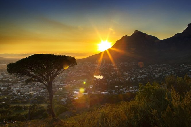Cape Town, a sleepy city in the west of South Africa, is renowned as being one of the best vantage points in the world from which to witness the sun rise, seen here peeking around Lion's Head© Getty Images