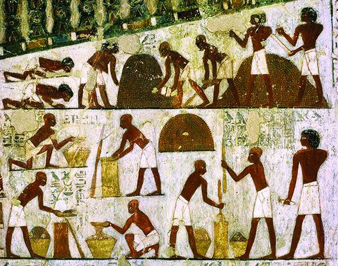 Hình vẽ cổ xưa diễn tả cách dân Ai Cập từng làm bánh mì, với cách giã bột và cách nướng trong lò nung. Ảnh: tavolamediterranea.com