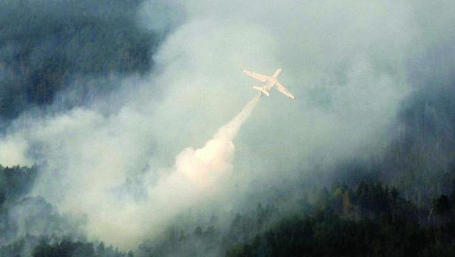 Theo RIA Novosti, ngày 28-7, Bộ Tình trạng khẩn cấp Nga đã huy động nhiều máy bay tham gia chữa cháy rừng ở Siberia. Ảnh: ria.ru