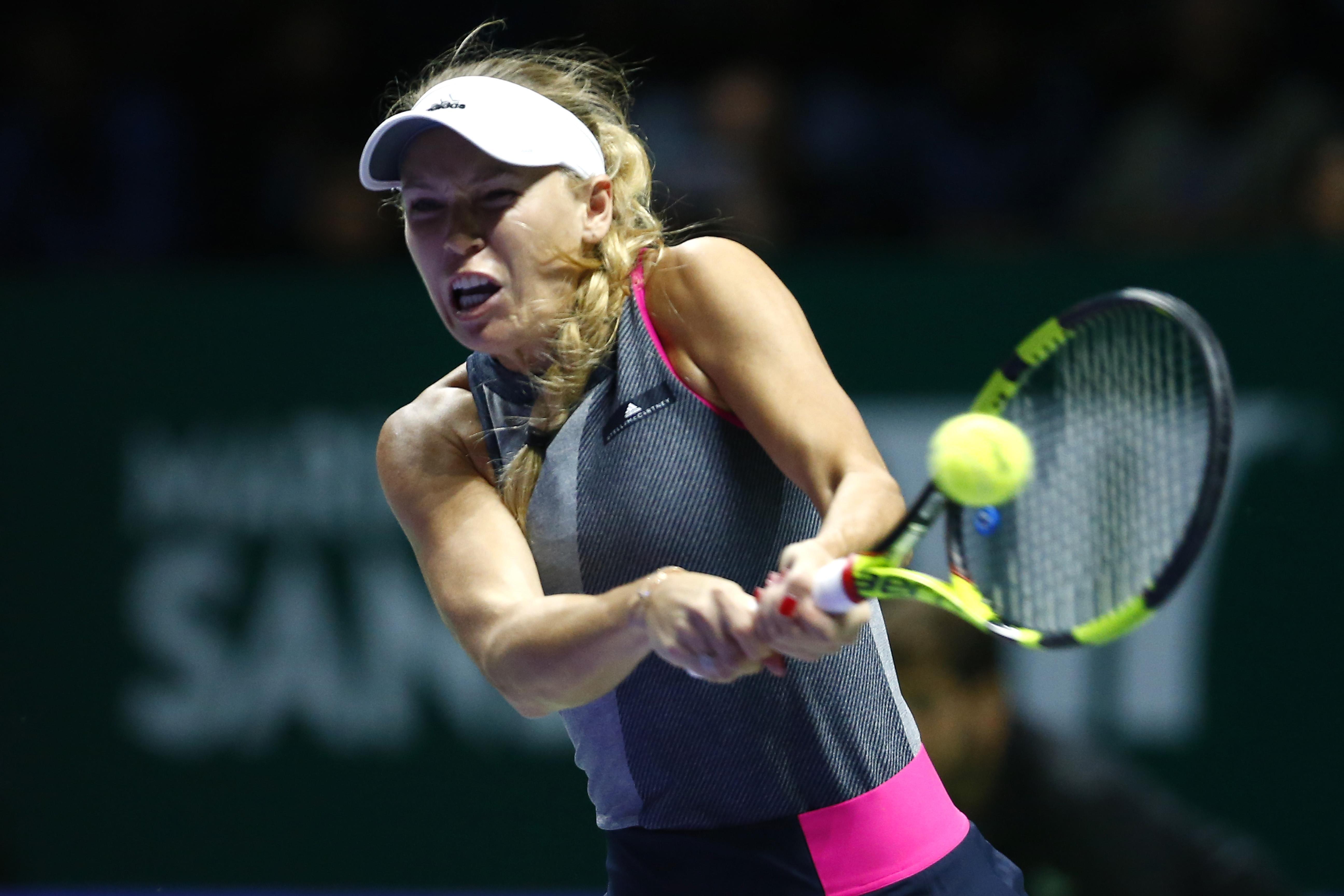 Wozniacki trong trận chung kết với Venus. Ảnh: REUTERS