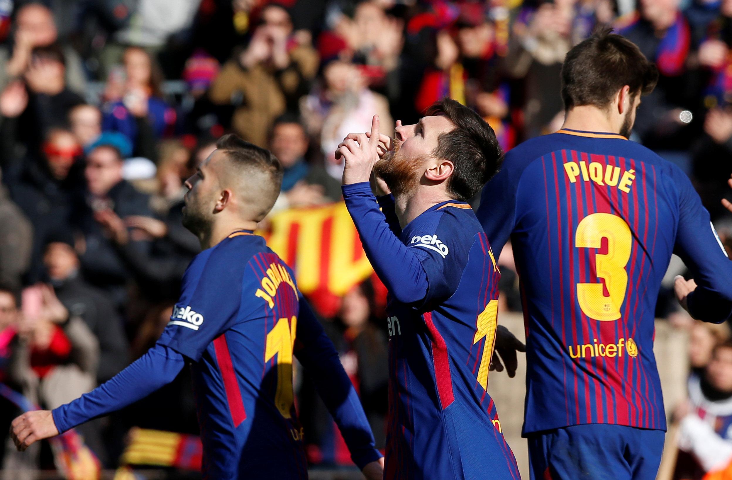 Messi ăn mừng bàn gỡ 1-1 cho Barca. Ảnh: REUTERS