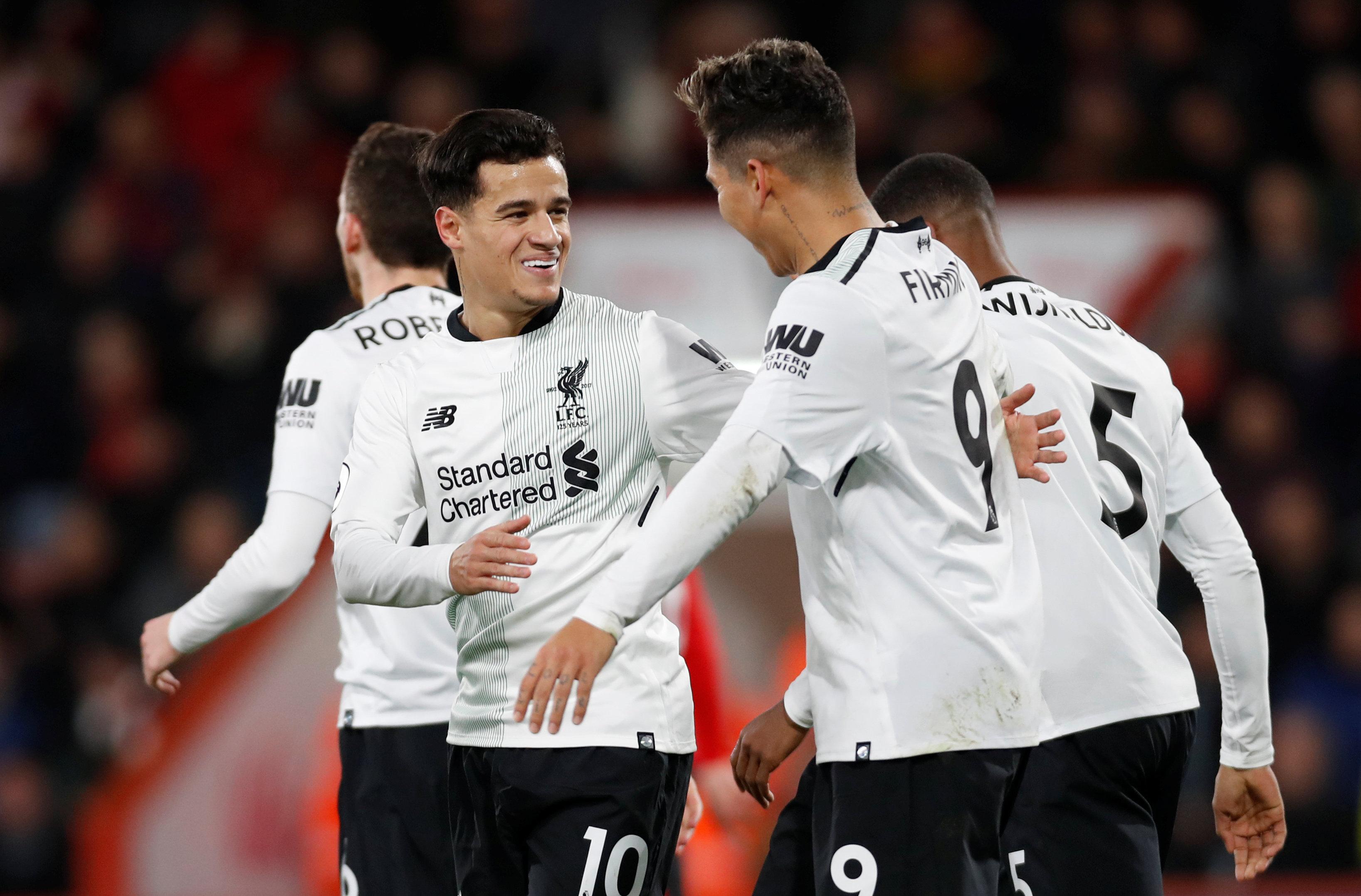 Niềm vui của Coutinho (trái) sau khi mở tỉ số cho Liverpool. Ảnh: REUTERS