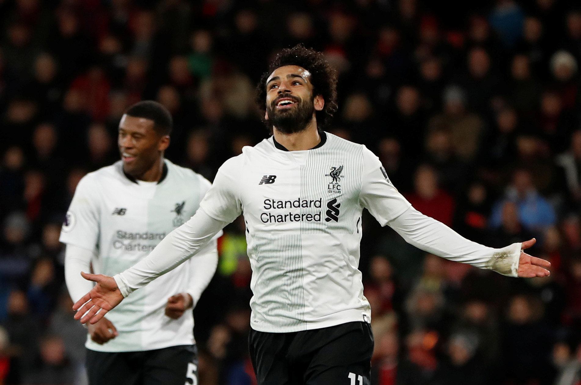 Salah ăn mừng bàn nâng tỉ số lên 3-0. Ảnh: REUTERS