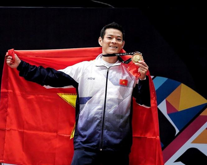 Lực sĩ cử tạ Thạch Kim Tuấn là một trong những VĐV nhận được thưởng lớn nhất trong năm với 754 triệu đồng-Ảnh: NAM KHÁNH