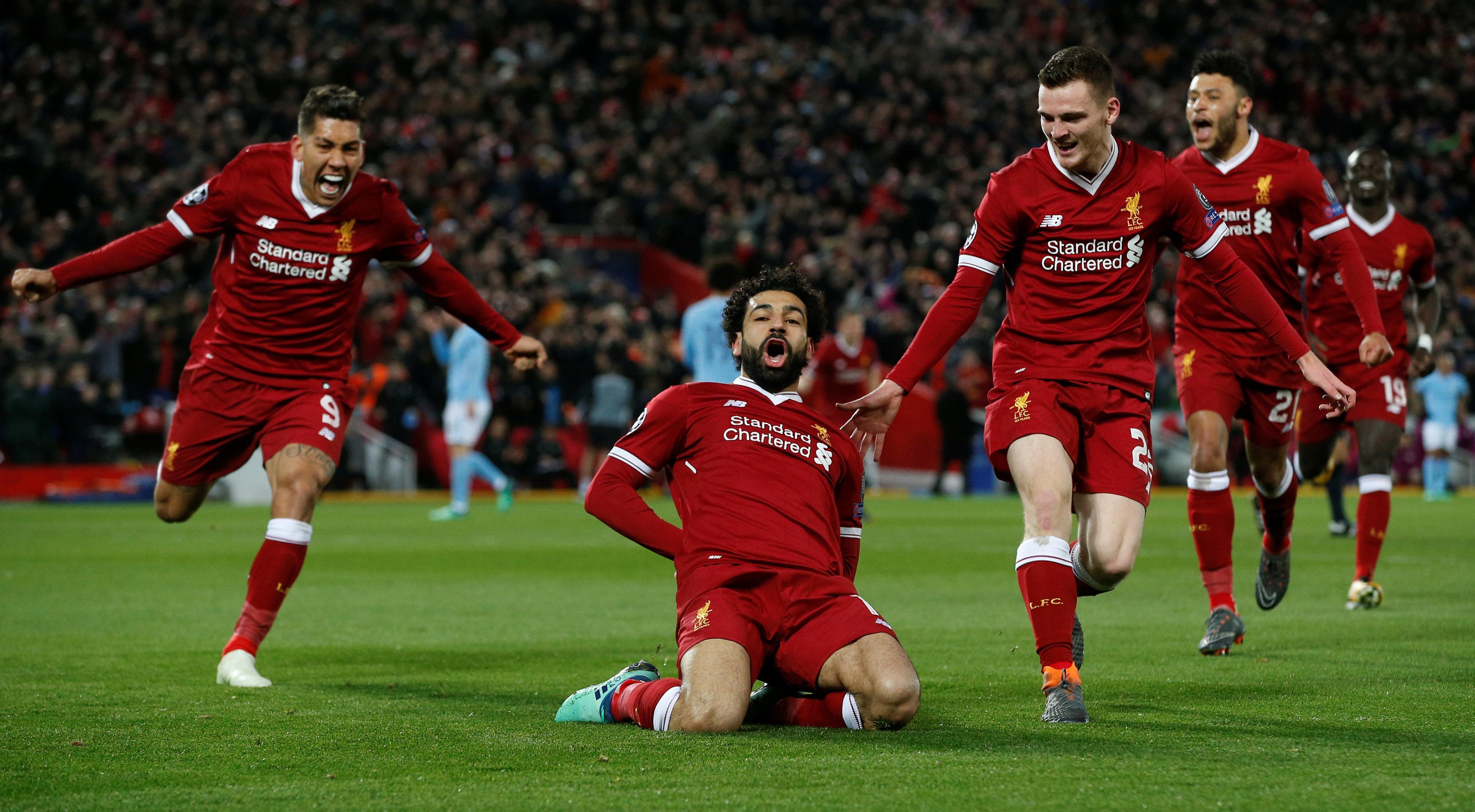 Niềm vui của Salah sau khi ghi bàn cho Liverpool. Ảnh: REUTERS