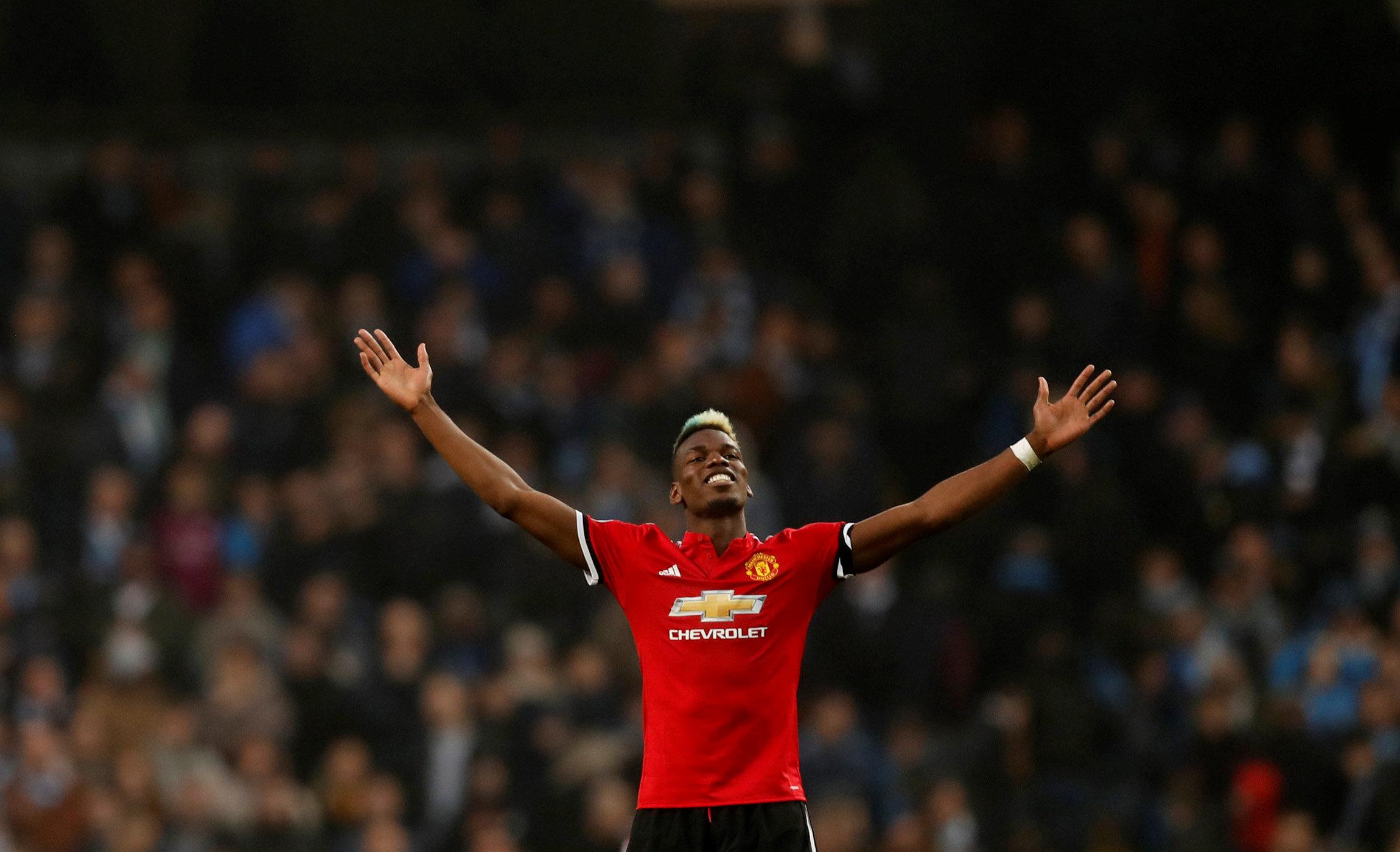 Pogba ăn mừng sau trận thắng ngoạn mục trước M.C. Ảnh: REUTERS