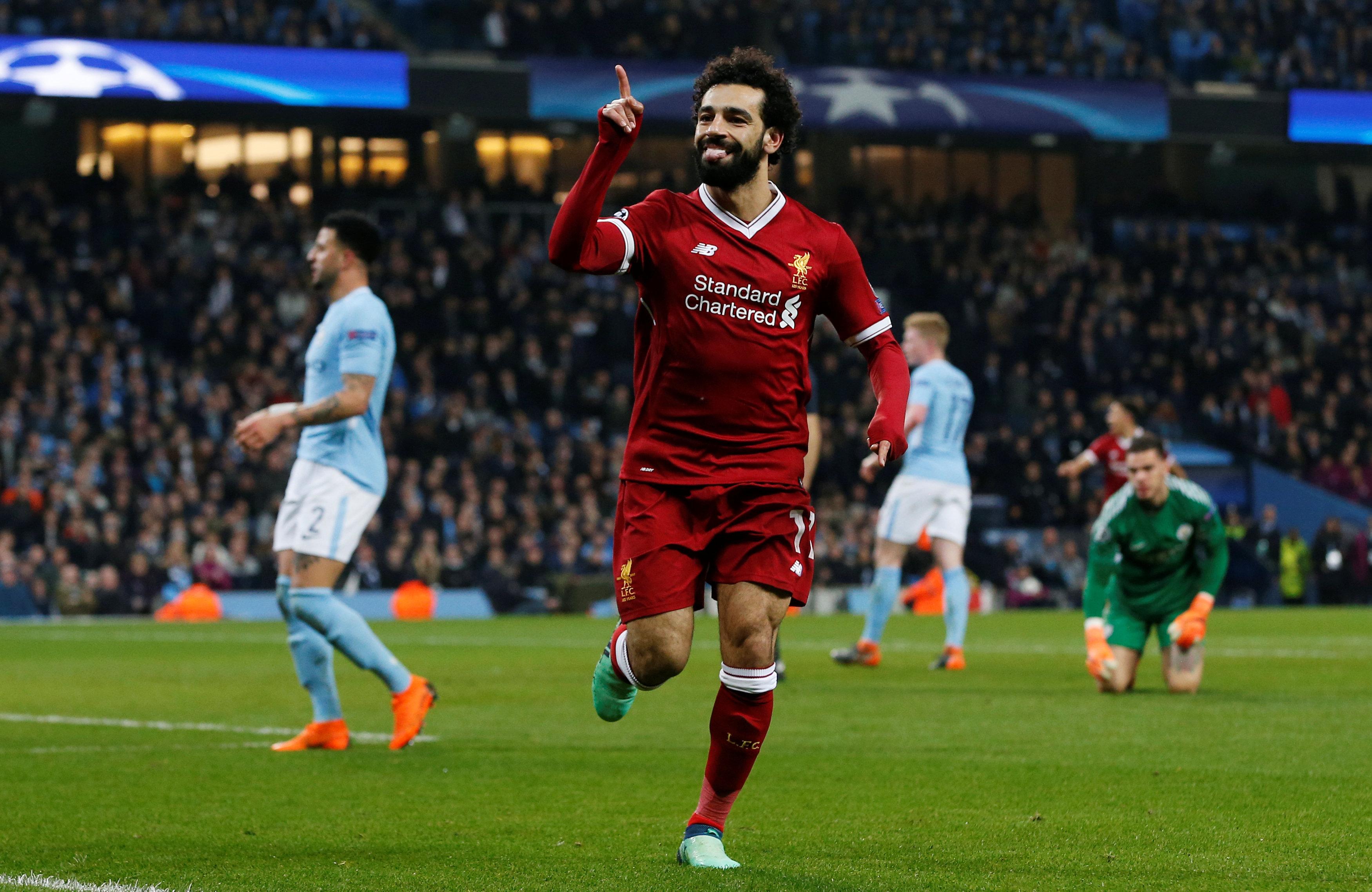 Salah ăn mừng bàn gỡ 1-1 cho Liverpool. Ảnh: REUTERS