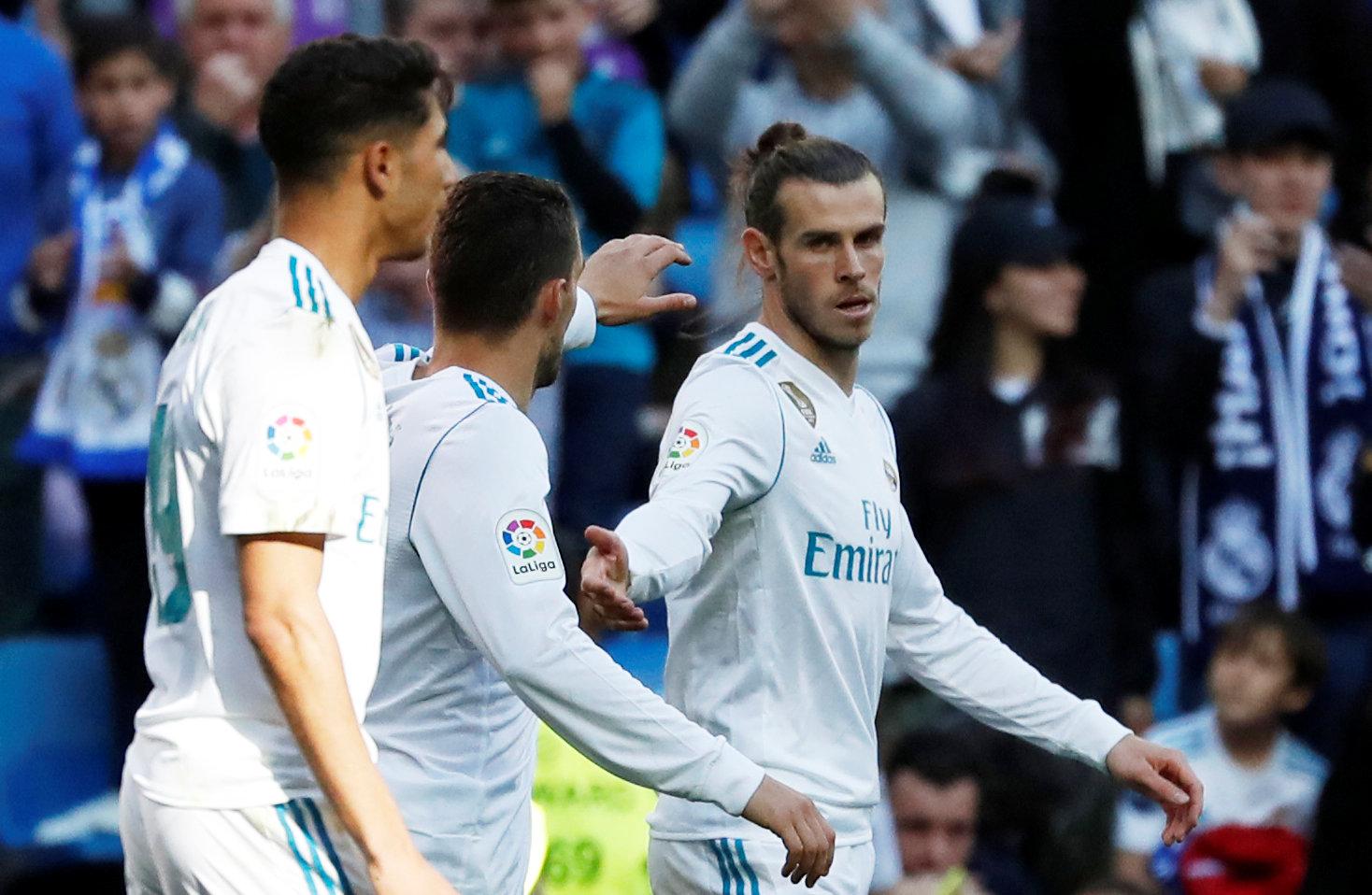 Bale (bìa phải) ăn mừng bàn mở tỉ số cho R.M. Ảnh: REUTERS