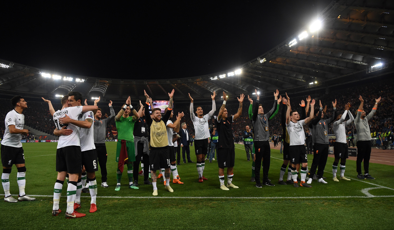 Thầy trò HLV Jurgen Klopp ăn mừng sau vòng bán kết Champions League Ảnh: Reuters
